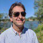 headshot photo of Eric Grodsky