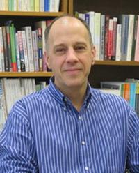 Headshot of Jim Raymo