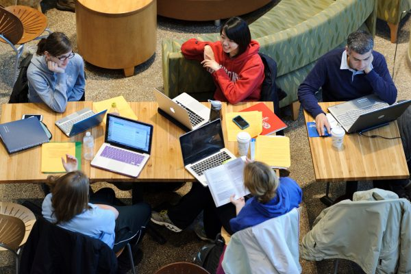 Students -- many with laptop computers -- study and socialize in the Sun Garden at Union South at the University of Wisconsin-Madison