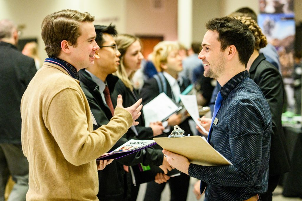 Two students discussing during the career fair.
