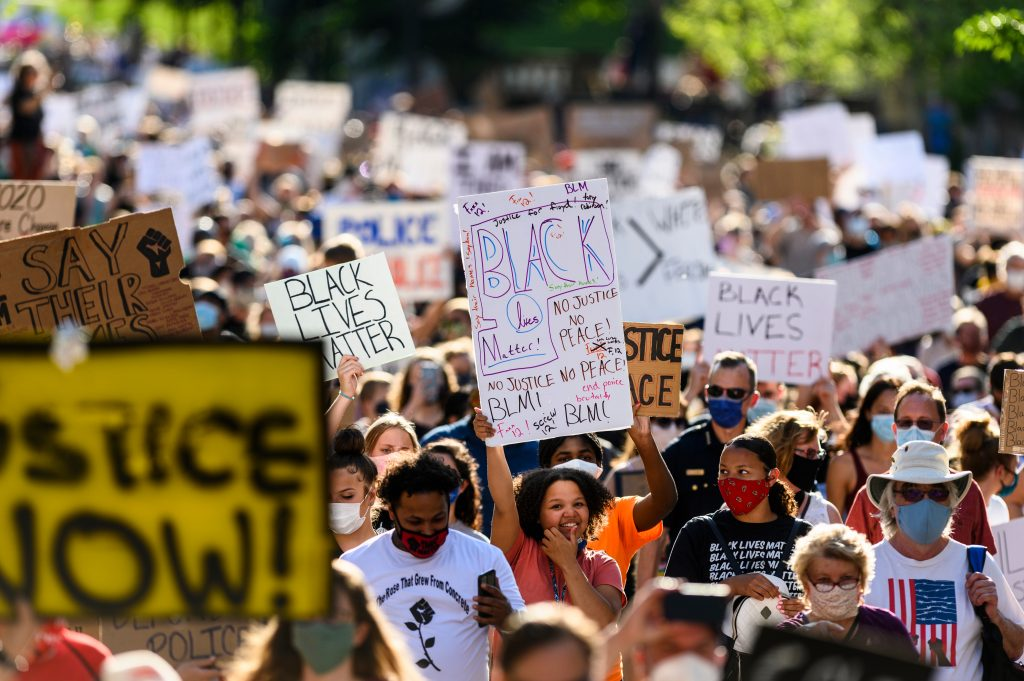 Thousands of demonstrators gather and speak out against racism and racial injustice as they walk through Library Mall at the University of Wisconsin-Madison for a Black Lives Matter Solidarity March on June 7, 2020.